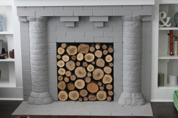 Fireplace filled with wood logs